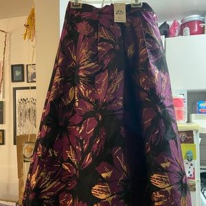 Black, purple, gold floral skirt. NWT.